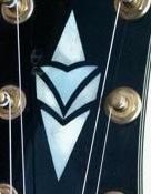グレコギターレスポールカスタムについて このヘッドインレイの頃の物はどうですか? また何年位前の物か?当時の定価など知ってる方、教えてください。