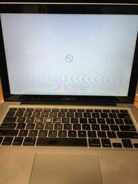MacbookProを電源ボタンを押して起動すると下のようになります。しかし、オプションボタンと電源ボタンを同時押しで起動しようとすると、起動します。どうすれば直るでしょうか?