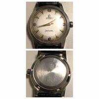 古いOMEGAの腕時計について 写真と時計が家にあったのですが、何年製の物か分かりますか? 祖父が自動巻・手動巻の時計が好きで、収集していました。 あまり自分の好みの時計ではないので、売る可能性もあります...