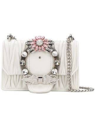 miumiuの、写真のような花のクリスタルの財布って、販売していましたか?