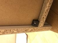 ニトリのテレビボードを組み立てたのですが この黒い部品を取り付ける意味がわかりません 名称も説明書に書いていません 理由はなんなのでしょうか?