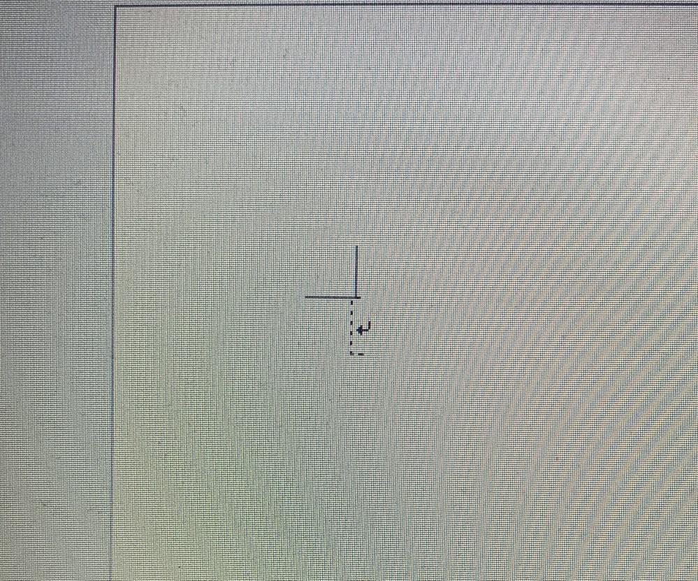 Wordを使用してる際に改行をしたら画像のような点線?が入ってしまいました。 これを消すにはどうしたらいいですか? スマホで見たら入っていなくパソコンのみです。