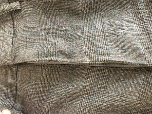 夏服ズボンのチャックがおかしくなってます。 アイロンをかけてもダメでした。クリーニングに出したらなんとかなりますか?
