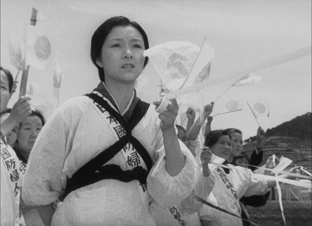 戦争の時兵士たちを見送る婦人会の人たちが手に取る長い白い糸(?)みたいなものは何ですか?画像は映画「二十四の瞳」からのです。