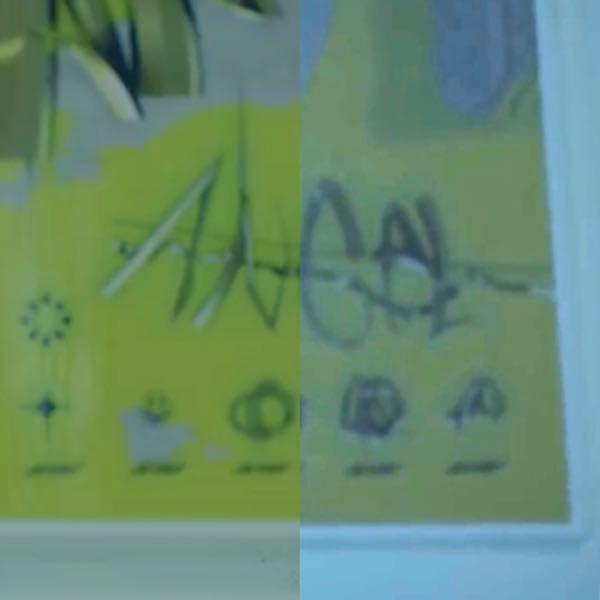 とあるMVに出てくるセットに気になる絵が描いてあったので、この絵について関連がありそうな事や物があれば、教えてください。 推察の上で役に立つ可能性があるものを列挙しておきます。 ・真ん中の文字は...
