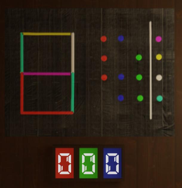 暗号の意味が解りません。 下の画像はとある脱出ゲームの暗号で三桁の数字が解れば鍵が開くと言うものです。 この暗号のヒントとしては 「右の表は赤青緑を重ね合わせるとどの色になるかを示しています。 左の
