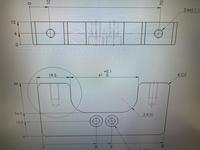 製図方法の質問です。 正面図のタップは位置や深さの指示をしないで、イメージしやすいように半透明の図にしていますが、〇内のタップにも中心線は必要なのでしょうか? 上面図で記載しているから不要だと考えていて社内で議論になっております。 上面図と中心線が繋がっていたり、何か指示していたら必要なのは分かるのですが、今回は不要な線になると考えております。 ルールがあるなら教えていただきたいです、調べて...