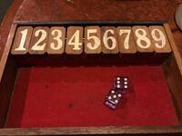 このボードゲーム名前とルール教えて欲しいです。 数字の裏にジャックポットって書いてあります