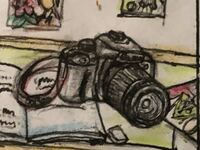中学生の時に描いた漫画の一部に描かれた一眼レフカメラの絵です。機種は何に見えますか?