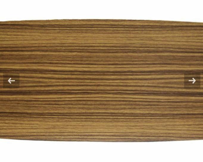 メラミン化粧板についての質問です。 ズバリこのメラミン化粧板の品番を教えてください! そのものズバリがない場合は近い品番教えて下さい。 ゼブラウッドでしょうか? メラミン化粧板なのは間違いないです。