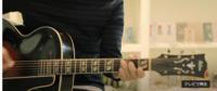 こちらの画像のギターのメーカー名やモデル名についてご存じの方はいらっしゃいますでしょうか? ヘッドの部分の文字がぼやけていて判別できませんでした。ご存じの方いらっしゃいましたら教えていただきたいです。何卒よろしくお願い致します。