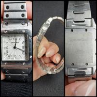 すごく昔にオークションで購入したカルティエの時計が掃除をしていたら出てきました。 電池がなくなり動いていないので電池を変えに行こうと思ったのですが、ふと「これ本物なのかなぁ?」と疑問に思いました。 ネットで探しているとだいたいカルティエはリューズ部分(ねじまき部分)にブルーのサファイアがついています。私のは何もついていません。 わかる方いましたら教えてください(^-^)