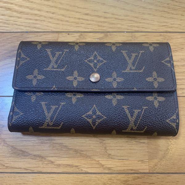この財布は本物ですか? シリアルナンバーはM61202です。 ボタンのところに @ LOUIS VUITTON PARIS made in Spain って書いてます。
