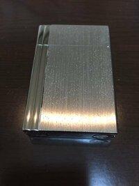 ライターの写真のような白い点を取る方法はありますでしょうか? ライターはデュポン18313で真鍮です。