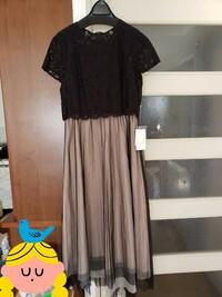 結婚式に着て行く服装についてです。  今月、友人の結婚式があるので新しくワンピースを購入しました。 このワンピースはマナー違反でしょうか。 半袖なので、上にボレロを着る予定です。