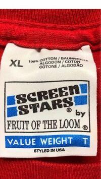 バンドTシャツ vintage 古着 あるお店の通販サイトにてvintageのバンドTシャツ の購入を検討しています。  タグはSCREEN STARS(アイルランド製)で シングルステッチになっています。 ※タグは写真を参考にしてください。  giantやanvilボディでコピーライト付きの 同デザインのTシャツを見るのですが このTシャツにはコピーライトが付きません。  ボディやステッチ...