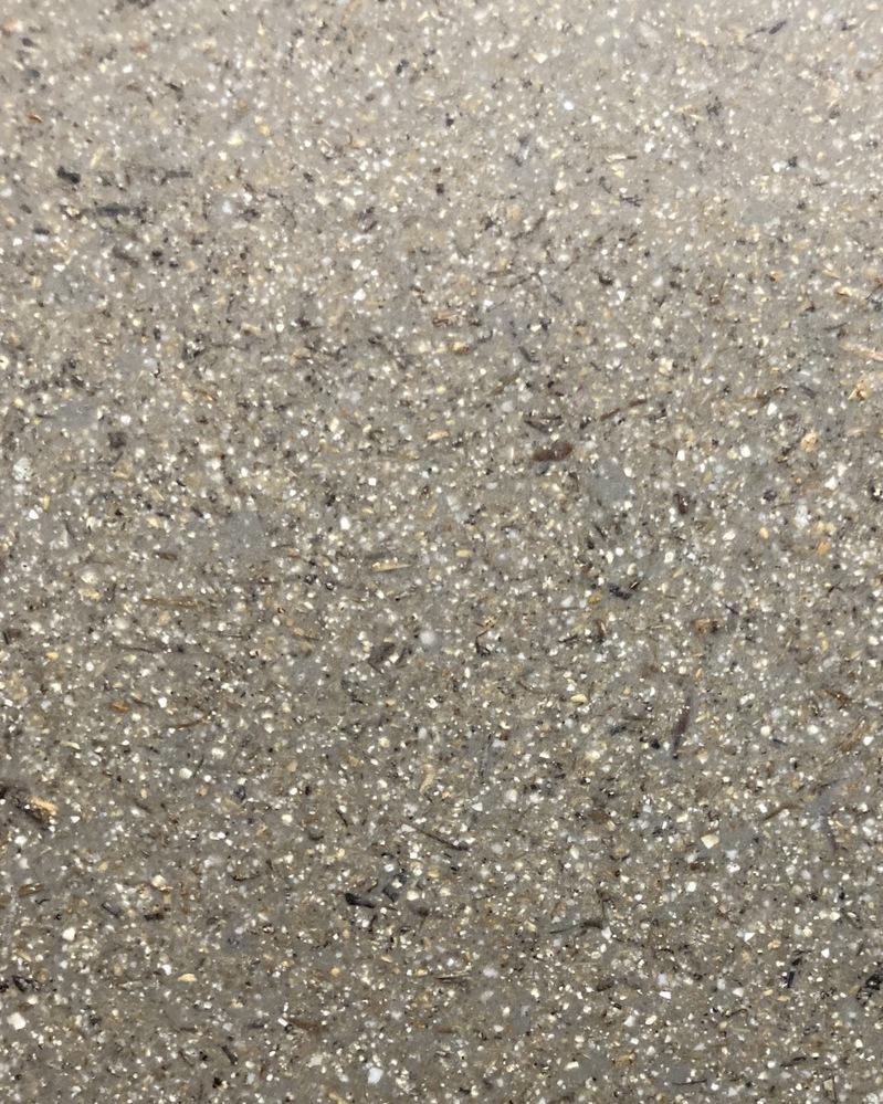 素材の名前を教えてください。 プラスチックに繊維や細かい石が混ざったような見た目をしています。プランターなどによく使われています。 正しい名称があるなら知りたいです。 よろしくお願いします。