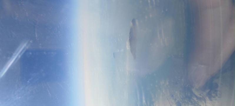 沖縄に行く途中、飛行機から噴火してる無人島のようなものを見ましたが、これはなんて島ですか?
