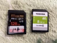 SDカードからiPhoneへの読み込みが出来ません。 読み込みにはSDカードリーダーを使ってます。 緑の方のSDカードからは読み込みマークが出て可能なのですが、黒い方のSDカードだと読み込みません。何が原因があるのでしょうか?