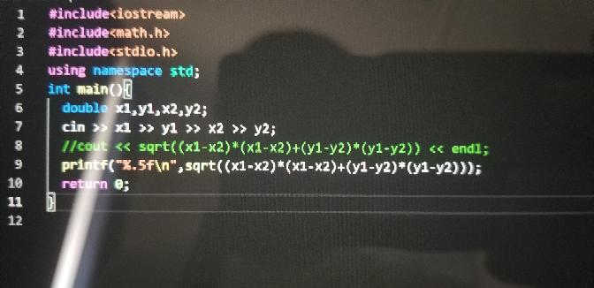 AOJの問題についての質問です。添付のプログラム?をどのように理解すればよいですか。 まず、2行目によってsqrt()の()内を計算する。 3行目によって、インプット、アウトプットを定義する? 4行