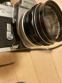フィルムカメラのレンズ左下にあるボタンは何のボタンなのでしょうか?カメラはminoltaのsrt101です。