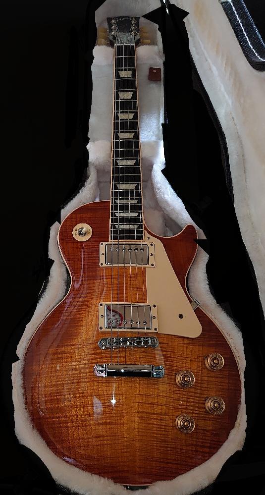 ギター、中古販売について。 gibson les paul traditional 2013 キャラメルバーストを所持しています。 こちらは売ると凡そいくらくらいになりますでしょうか?また、何年たっても売る時の値段は変わらないのか、下がるか上がるかどちらでしょうか。変わらない。または安くなる一方ならもう売ろうかと考えています。