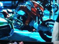ワイルドスピード MAX に出てくるバイクの名前を教えてください。 ワイルドスピード MAX に出てくるバイクの名前を教えてください。   ワイルドスピード MAX の最初の方に出てくる赤いバイクの名前が知りたいです。 ポール・ウォーカーがレース会場に着いて車から降りる少し前に映り込んでいたバイクです。  わかる方いたら教えてください。