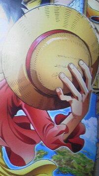 ルフィの麦わら帽子の傷について の麦わら帽の傷は誰につけられたんでしたっけ?
