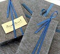 この写真の紐の結び方、あるいは結び方の名前を教えてください! よろしくお願いします。
