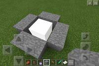 マインクラフトPEで謎の白いブロック見つけた。スライムブロック付けたピストンで押したら飛ぶし水にも流されるしなんですかこのブロックは雲ですか?知っていたら教えてください。