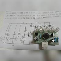 回路図について  添付画像は、練習用のキットではんだづけしました。  回路図通りにはんだ付けできていますか? 真ん中の黒の部品がわかりません。 名前を教えて下さい。  宜しくお願い します!