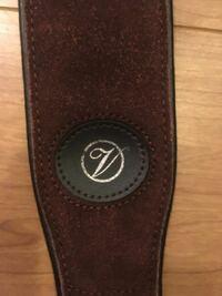 ギターストラップのブランド こちらのストラップが自宅にあったのですが、どこのブランドか分かりますか?  このロゴ以外の記載がありません。