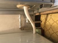 洗濯機を設置する際、排水ホースが写真のように一度少し上に上がってしまいます。 きちんと排水出来ないですかね?
