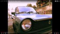 ノーナリーブスのLOVE TOGETHERのMVに出てくる車の名前とメーカーを教えてください。画像に写っている車です。