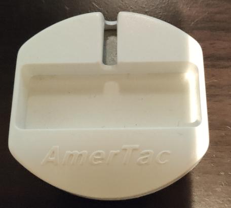今日掃除してたらなんの部品かわからないので教えてください。 AmerTacと書かれています。