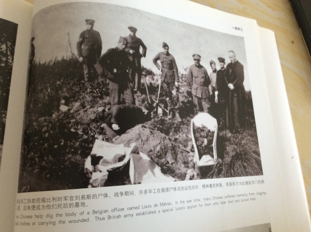 Two Chinese help dig the body of a Belgian officer named Louis de Mahieu. ln the war time, many C...
