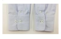 ワイシャツ袖口のお直しについて  ワイシャツの袖口が広すぎた為、カフスのボタン位置を狭目の位置にボタンを付け替えました。 その場合、剣ボロ?の位置は移動させないと着用時、不自然になるのでしょうか?  元々袖口にボタンが二つあるタイプの場合は狭い方で着用した場合、剣ボロが少しズレることになると思いますがそれと同じと思って良いですか?  素人で何も分からず、教えて頂けると助かります。...