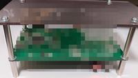 電子基板のネジ穴に付けるタップ?足の呼び名。 当添付している画像、基盤の四つ角部分(ネジ穴)に取り付けている「タップ?足」が欲しいのですがこういう物はなんという商品名などで売られているのでしょうか?  電子工作、自作PCなどお詳しい方、商品名分かる方居ましたらご回答をお願いします。