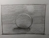 デッサンの添削をお願いします。  逆光の球体を描きました。 影、ハイライト、環境光の付き方に関し至らぬ点がございましたら、ご指南をお願いします。