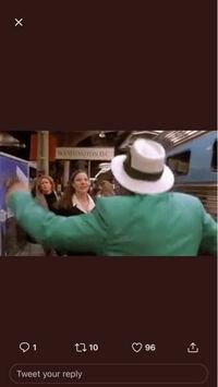 これって何の映画ですか?緑スーツの男性が男と女をビンタして倒してます