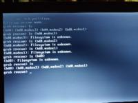 Windows7とubuntuをリュアルブートさせてたんですけど、なにも考えずにWindows7からubuntuのパーティションを消したら起動できなくなってしまいました。画像は ls (hd0~を全部行ったところですが、ひとつだけ違うも のがあるはずなのにありません。Windows7を起動させるにはどうしたらいいですか?