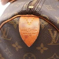 ルイヴィトンのバックのこの部分の名称を教えてください。 バックのファスナーのサイドについている革の部分です。