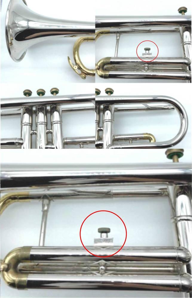 トランペットのこの部品の役割は? ・ 写真の赤丸で囲んだ部品、通常であれば、これにトリガーというかリングを取り付けると思うのですが、この機種(NIKKAN、TR134)は、第3抜差管がリバースではないので、この位置にトリガーを付けても指で長さを調整できません。 そのためか、同型機種の出品を見ると、どれもトリガー金具が付いていません(古いから紛失したのかもしれませんが)。 NIKKAN、TR134 https://page.auctions.yahoo.co.jp/jp/auction/b551335750 一方、NIKKANトランペット NO.20というのがあります。 https://page.auctions.yahoo.co.jp/jp/auction/t807760282 ・ 写真で見たところ、両者は類似点が多いです。というか、酷似しています。前記の部品以外にも、たとえば、全体がシルバーなのに、抜差管は金メッキ(あるいはラッカー?)とか、支柱の取り付け方とか……。 【質問1】この赤丸部分の金具は、なんのために付いていますか? 【質問2】NIKKANトランペット NO.20はどんな楽器ですか? 【質問3】NIKKAN NO.20とNIKKAN、TR134は、どういう関係なのでしょうか?