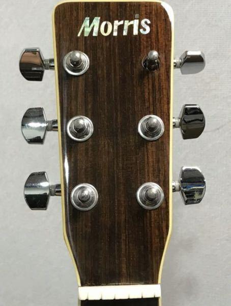 ギターのここの部品はなんですか? ヘッドの金具が一部分欠損してるんですけど、名前が分かりません。楽器屋さんに行けば売っていますか?