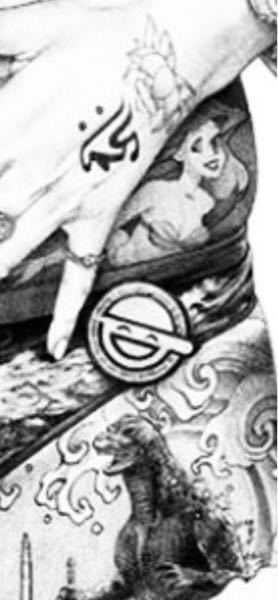 大友昇平さんの平成聖母のデザインで一点思い出せないのがあります。 ゴジラの真上にあるスマイルマークみたいなやつなのですが、これってなんでしたかね?わかる方教えて下さい〜