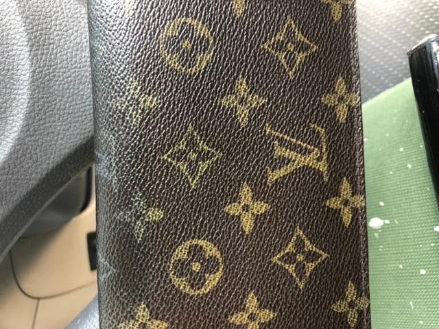 知り合いからもらったヴィトン長財布 LVのマークがきえてるんですが これは本物ですか?